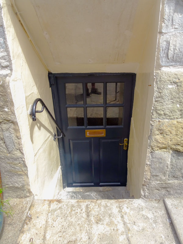 Steps down to a low door and foot doorfie, Lyme Regis, Dorset, August 2021