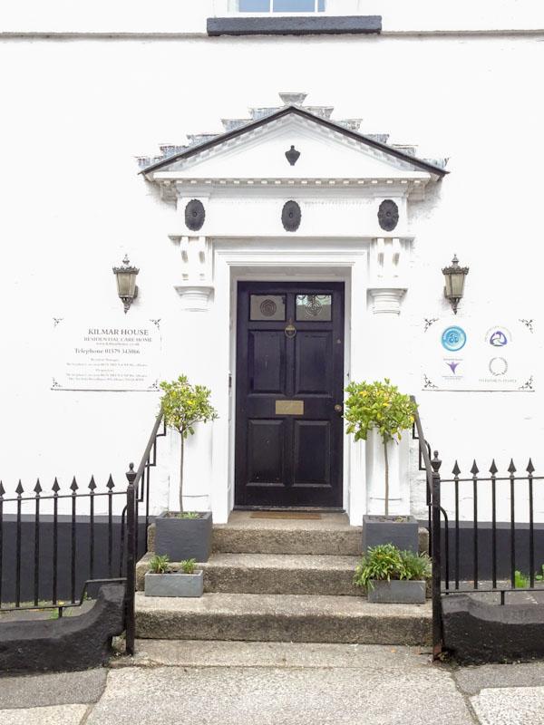 Door with grand portico, Liskeard, Cornwall, August 2021
