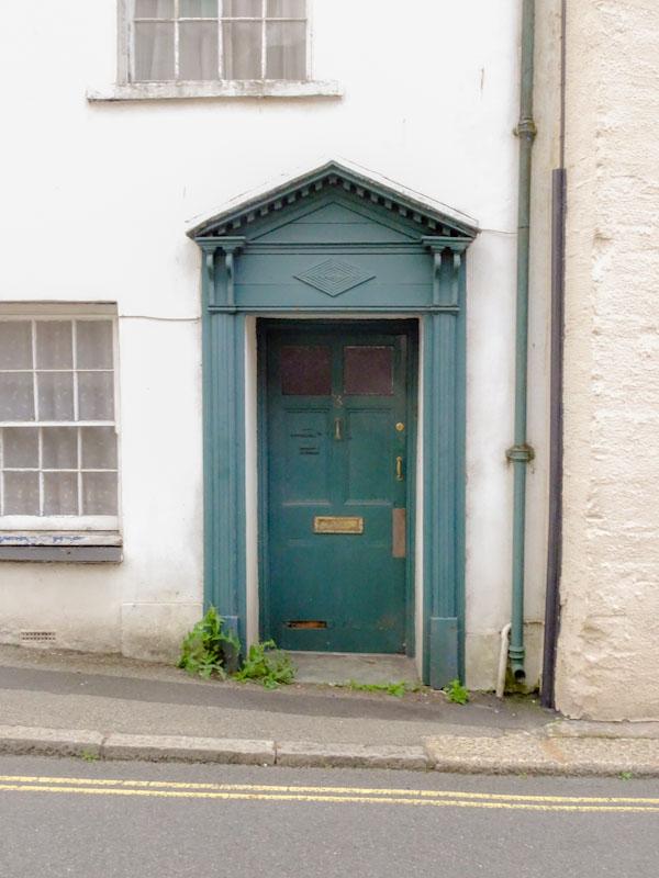Green door with portico, Liskeard, Cornwall, August 2021