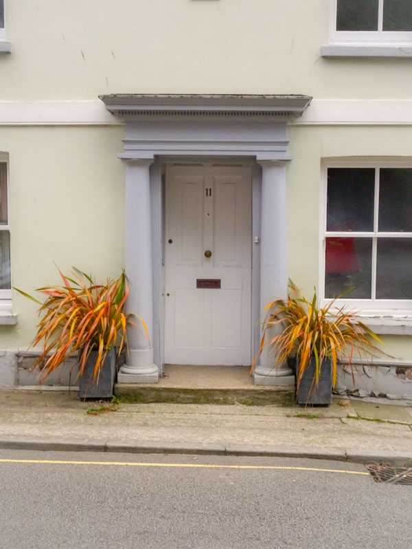 Door with portico and plant pots, Liskeard, Cornwall, August 2021
