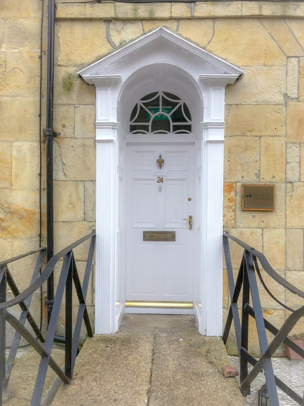 Door with nice portico and modern railings, Truro, Cornwall, August 2021