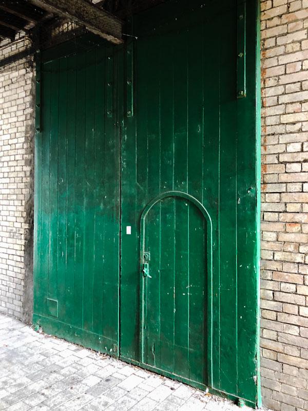 Green door within a door, Truro, Cornwall, August 2021