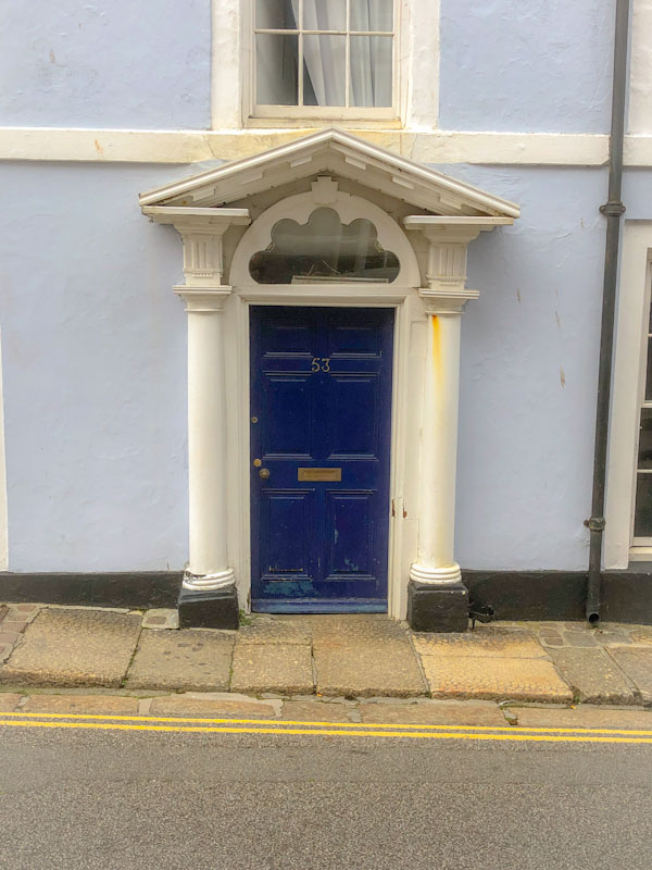 Blue door with superb neoclassical portico, Penzance, Cornwall, August 2021